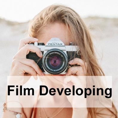 Film developing into prints or scanned to Google drive cloud.